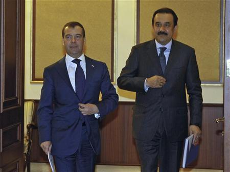Kazakhstan's Prime Minister Karim Masimov (R) walks with his Russian counterpart Dmitry Medvedev during their meeting in Astana, May 29, 2012. REUTERS/Dmitry Astakhov/RIA Novosti/Pool