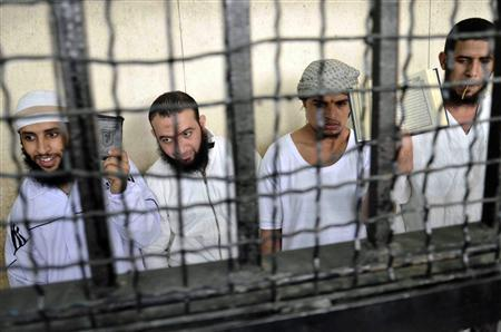 Militant Islamists react as they attend their verdict at a court in Ismailia city, about 120 km (75 miles) outside of Cairo September 24, 2012. REUTERS/Stringer