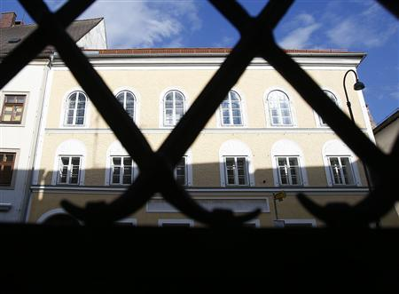 The house in which Adolf Hitler was born is seen through a fence in the northern Austrian city of Braunau am Inn September 24, 2012. REUTERS/Dominic Ebenbichler