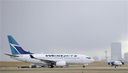 A Westjet Boeing 737-700 takes off at the International Airport in Calgary, Alberta, May 3, 2011. REUTERS/Todd Korol