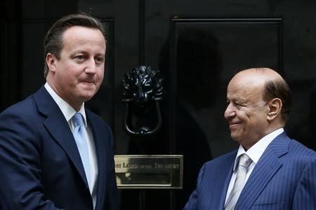 Britain's Prime Minister Cameron (L) greets Yemen's President, Abd Rabbuh Mansur Al-Hadi, at number 10 Downing Street in London September 24, 2012. REUTERS/Stefan Wermuth