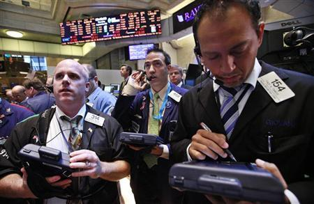 Traders work on the floor of the New York Stock Exchange, September 20, 2012. REUTERS/Brendan McDermid