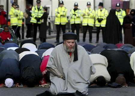 Muslim cleric, Abu Hamza al-Masri, is seen leading prayers outside the North London Central Mosque, in Finsbury Park, north London in this January 24, 2003 file photograph. The European Court of Human Rights on September 24, 2012 gave final approval for the extradition of Abu Hamza, along with four other individuals, from the UK to the U.S., local media reported. REUTERS/Toby Melville/Files