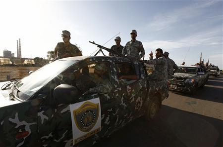 Libyan security forces head to a compound which had been taken over by an armed group in Tripoli September 23, 2012. REUTERS/Anis Mili