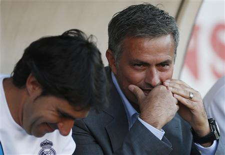 Real Madrid coach Jose Mourinho talks to second coach Aitor Karanka before their Spanish First Division soccer match against Rayo Vallecano at Teresa Rivero stadium in Madrid September 24, 2012. REUTERS/Susana Vera