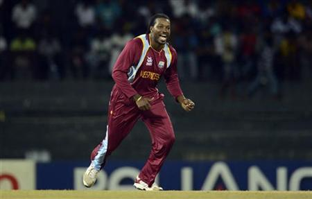 West Indies' Chris Gayle celebrates after the dismissal of Ireland's Gary Wilson during the ICC World Twenty20 Group B match at the R Premadasa Stadium in Colombo September 24, 2012. REUTERS/Philip Brown