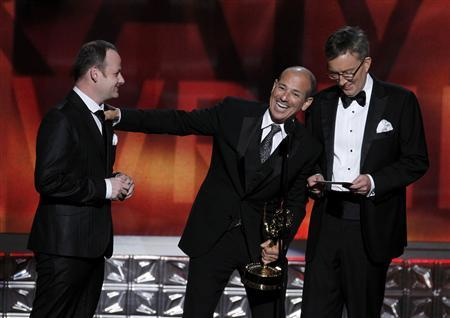 Howard Gordon thanks writer Gideon Raff (L) and writing partner Alex Gansa (R) as they accept the award for outstanding writing in a drama series for ''Homeland'' at the 64th Primetime Emmy Awards in Los Angeles, September 23, 2012. REUTERS/Lucy Nicholson