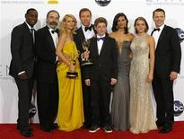 "The cast of ""Homeland"" L-R: David Harewood, Mandy Patinkin, Claire Danes, Damian Lewis, Jackson Pace, Morena Baccarin, Morgan Saylor and Diego Klattenhoff, pose after the series won the Emmy award for outstanding drama series at the 64th Primetime Emmy Awards in Los Angeles September 23, 2012. REUTERS/Mario Anzuoni"