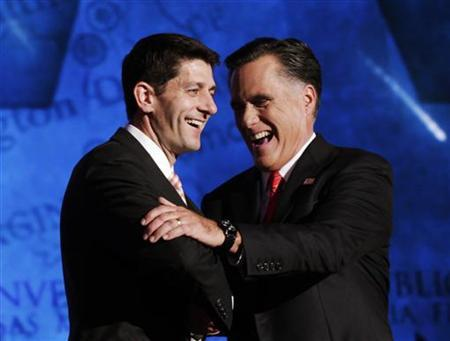 Republican presidential nominee Mitt Romney shakes hands with vice presidential running mate Rep. Paul Ryan (L) after accepting the nomination during the final session of the Republican National Convention in Tampa, Florida August 30, 2012. REUTERS/Shannon Stapleton