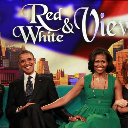 U.S. President Barack Obama and first lady Michelle Obama take part in a taping of the ''The View'' chat show at ABC's studios in New York, September 24, 2012. The show will air on September 25. REUTERS/Jason Reed