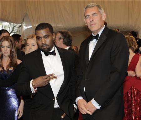 Kanye West (L) and Lyor Cohen arrive at the Metropolitan Museum of Art Costume Institute Benefit celebrating the opening of Alexander McQueen: Savage Beauty, in New York, May 2, 2011. REUTERS/Eric Thayer