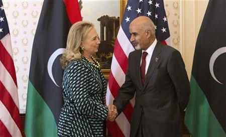 U.S. Secretary of State Hillary Clinton meets with Libyan leader Mohammed Magarief on the sidelines of the United Nations General Assembly in New York, September 24, 2012. REUTERS/Andrew Kelly