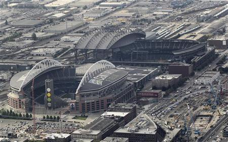 This aerial view looking south shows the cluster of Seattle's current NFL and MLB professional sports stadiums and also the adjacent location where billionaire Chris Hansen has proposed to build a NBA/NHL arena as pictured from a helicopter August 21, 2012. Pictured from left to right is Qwest Field which is home to the NFL's Seattle Seahawks and Safeco Field which is home to the MLB's Seattle Mariners. In the upper right hand corner of the photo directly next to Safeco Field is the location where Hansen wants to build an NBA/NHL arena. REUTERS/Anthony Bolante