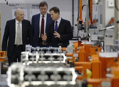 Britain's Deputy Prime Minister and leader of the Liberal Democrat Party Nick Clegg (R), and Business Secretary Vince Cable (L), speak with managing director Martin Fausset during their visit to engineering company Ricardo UK's Shoreham Technical Centre near Brighton, southern England September 24, 2012. REUTERS/Luke MacGregor