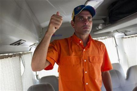 Venezuela's opposition presidential candidate Henrique Capriles prepares to step out of his campaign bus as he arrives to a campaign rally in Maracay, about 100 km (62 miles) west of Caracas September 23, 2012. REUTERS/Carlos Garcia Rawlins