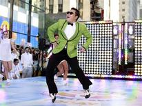"Korean rapper-singer Psy performs on NBC's ""Today"" show in New York in this September 14, 2012 file photograph. A pop star whose song ""Gangnam Style"" became the first Korean hit to top Apple's music download charts has also worked his magic on his father's software firm, helping it double in value since singer and dancer Psy burst onto the global scene in July. Psy's father, Park Won-ho, is the chairman and controlling shareholder of South Korean semiconductor company D I Corp and its market capitalisation has surged to 113.5 billion won (62.4 million pounds) on the main Seoul bourse, making it as of September 25, 2012. the 459th most valuable stock measured by size. REUTERS/Brendan McDermid/Files"