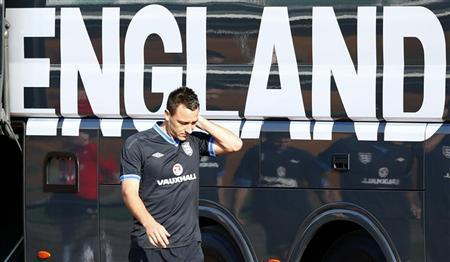 England's John Terry arrives for a soccer training session in London Colney, north of London, September 3, 2012. REUTERS/Darren Staples