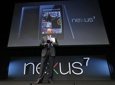 Google Executive Chairman Eric Schmidt poses with the Nexus 7 tablet at a promotional event in Tokyo September 25, 2012. REUTERS/Kim Kyung-Hoon