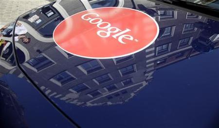 A Google logo is pictured on a Street View car in Riga August 26, 2011. REUTERS/Ints Kalnins/Files
