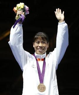 Bronze medallist Chungneijang Mery Kom Hmangte of India poses during the medal ceremony for the Women's Fly (51kg) boxing competition at the London Olympic Games August 9, 2012. REUTERS/Murad Sezer