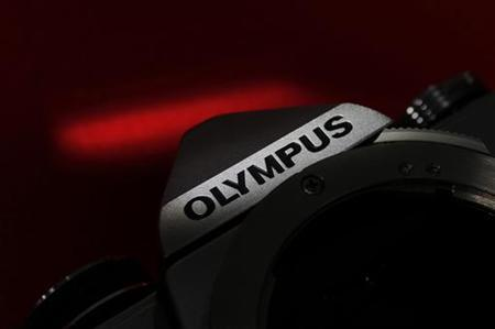 The Olympus logo on its camera is seen in this illustrative photograph taken in Tokyo November 24, 2011. REUTERS/Kim Kyung-Hoon
