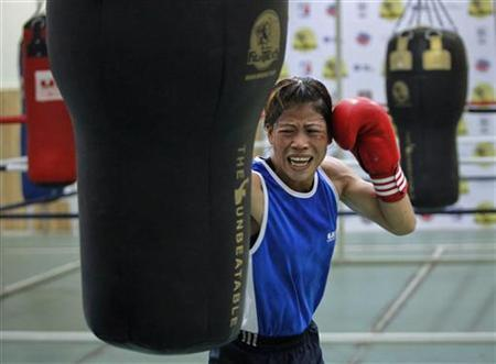 Boxer MC Mary Kom punches a bag during a training session at Balewadi Stadium in Pune, about 190 km from Mumbai, March 12, 2012. REUTERS/Danish Siddiqui/Files
