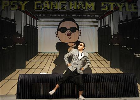 South Korean singer Psy dances after a news conference at a hotel in Seoul September 25, 2012. REUTERS/Kim Hong-Ji