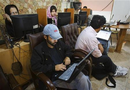 Customers use computers at an internet cafe in Tehran May 9, 2011. REUTERS/Raheb Homavandi