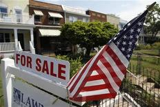 """A U.S. flag decorates a for-sale sign at a home in the Capitol Hill neighborhood of Washington, August 21, 2012. President Barack Obama said on Monday the U.S. housing market was """"beginning to tick up"""" but was still not where it needs to be. REUTERS/Jonathan Ernst"""