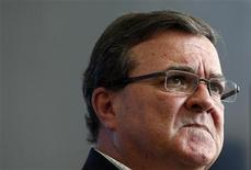 Canada's Finance Minister Jim Flaherty pauses during a news conference in Ottawa August 15, 2012. REUTERS/Chris Wattie