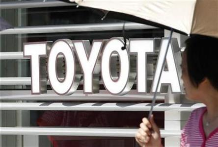 A woman walks out from a Toyoto Motor Corp showroom in Tokyo August 3, 2012. REUTERS/Yuriko Nakao