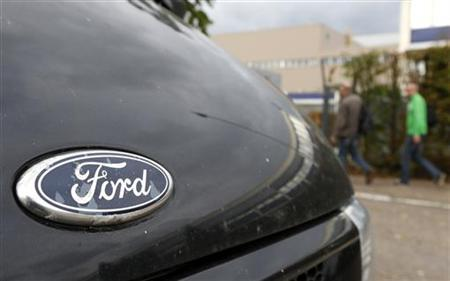 The logo of Ford is seen on a car while workers arrive at the Ford assembly plant in Genk September 18, 2012. REUTERS/Francois Lenoir