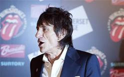 "Ronnie Wood of the The Rolling Stones walks away after posing at the opening of the exhibition ""Rolling Stones: 50"" at Somerset House in London July 12, 2012. REUTERS/Ki Price"