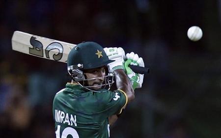 Pakistan's Imran Nazir plays a shot against Bangladesh during their Twenty20 World Cup cricket match in Pallekele September 25, 2012. REUTERS/Dinuka Liyanawatte