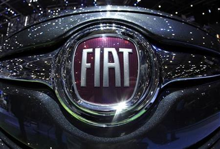 The Fiat logo is seen in a car displayed on the Fiat booth during the first media day of the Geneva Auto Show at the Palexpo in Geneva in this March 6, 2012 file photo. REUTERS/Denis Balibouse