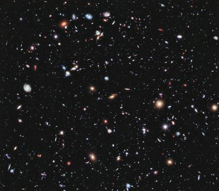 A new, improved portrait of Hubble's deepest-ever view of the universe, called the eXtreme Deep Field, or XDF, which shows a small area of space in the constellation Fornax, created using Hubble Space Telescope data from 2003 and 2004, is seen in this composite image released to Reuters on September 25, 2012. By collecting faint light over many hours of observation, it revealed thousands of galaxies, both nearby and very distant, making it the deepest image of the universe ever taken at that time, according to the news release. REUTERS/NASA, ESA, G. Illingworth, D. Magee, and P. Oesch (University of California, Santa Cruz), R. Bouwens (Leiden University), and the HUDF09 Team/Handout