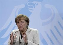 German Chancellor Angela Merkel delivers a speech at a presentation on a stereo music system during a reception of medallists of the Youth Researchers (Jugend Forscht) competition at the Chancellery in Berlin September 20, 2012. REUTERS/Tobias Schwarz