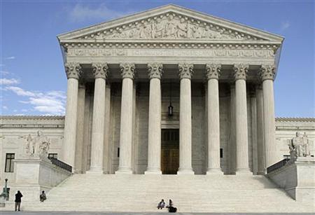 People relax on the steps of the U.S. Supreme Court in Washington, March 25, 2012. REUTERS/Stelios Varias