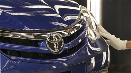 An employee inspects a compact car ETIOS as he trains at the assembly line of the new plant of Japanese automaker Toyota Motor Corporation in Sorocaba, 100km (62 miles) west of Sao Paulo, August 9, 2012. REUTERS/Paulo Whitaker