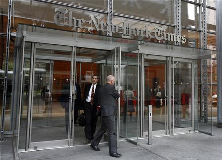 People leave the New York Times building at 8th Avenue and 41st Street in New York, April 21, 2008. REUTERS/Shannon Stapleton