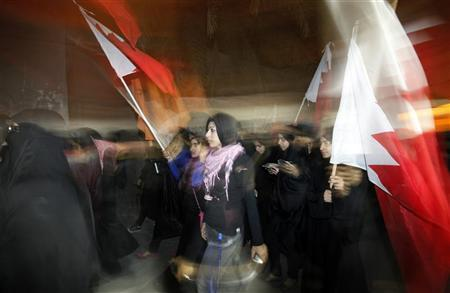 Zainab al-Khawaja (C), daughter of human rights activist Abdulhadi al-Khawaja, takes part in a rally held in support of her father in the village of Bani-Jamra, west of Manama March 11, 2012. REUTERS/Hamad I Mohammed