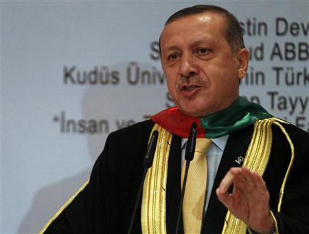 Turkish Prime Minister Tayyip Erdogan addresses the audience after receiving his Honorary Doctorate degree from Palestine's Al-Quds University in Ankara September 21, 2012. REUTERS/Umit Bektas