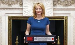 Author J.K. Rowling poses for photos with her certificate at Mansion House after being presented with the Freedom of the City of London May 8, 2012. REUTERS/Andrew Winning