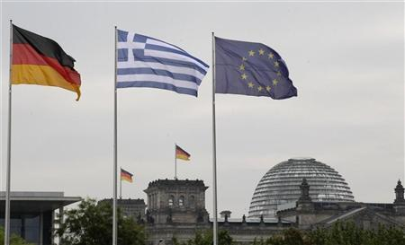 The flags of Germany, Greece and European Union flutter in the wind before a meeting between German Chancellor Angela Merkel and Greek Prime Minister Antonis Samaras in Berlin, August 24, 2012. REUTERS/Tobias Schwarz