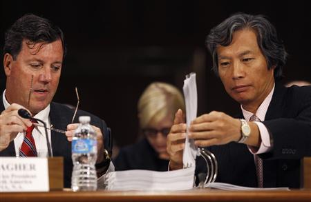 Former HSBC executive vice president Michael Gallagher (L) and HSBC former head of Global Banknotes Christopher Lok (R) look at documents during testimony at the Senate Homeland Security and Governmental Affairs Committee in Washington in this July 17, 2012 file photograph. At least 11 different U.S. departments, offices and regulators - largely comprising the two competing groups - as well as the U.S. Senate have probed HSBC for money-laundering lapses in investigations that date back to at least 2007. REUTERS/Gary Cameron/Files