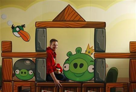 Rovio Entertainment Senior Vice-President Henri Holm poses with an Angry Birds setting at a news conference in Hong Kong July 3, 2012. REUTERS/Bobby Yip/Files