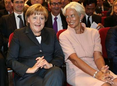 German Chancellor Angela Merkel (L) and the Director of the International Monetary Fund, IMF, Christine Lagarde, chat as they arrive for the 70th birthday reception for German Finance Minister Wolfgang Schaeuble, unseen, in Berlin, September 26, 2012. REUTERS/Michael Sohn/Pool