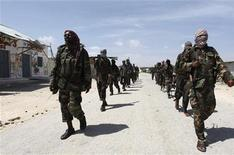 Al Shabaab soldiers patrol in formation along the streets of Dayniile district in Southern Mogadishu, March 5, 2012. REUTERS/Feisal Omar
