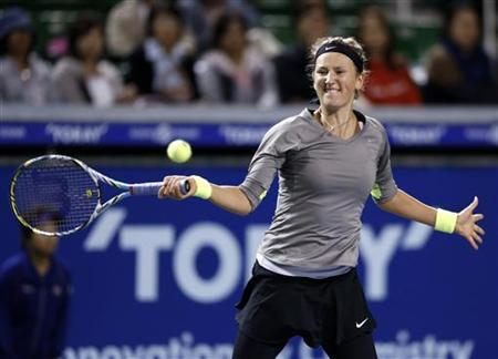 Victoria Azarenka of Belarus returns a shot against Roberta Vinci of Italy during their third round women's singles match at the Pan Pacific Open tennis tournament in Tokyo September 26, 2012. REUTERS/Kim Kyung-Hoon