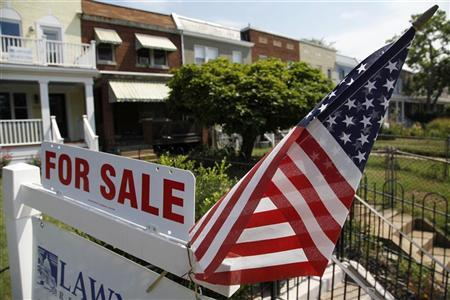 A U.S. flag decorates a for-sale sign at a home in the Capitol Hill neighborhood of Washington, August 21, 2012. President Barack Obama said on Monday the U.S. housing market was ''beginning to tick up'' but was still not where it needs to be. REUTERS/Jonathan Ernst